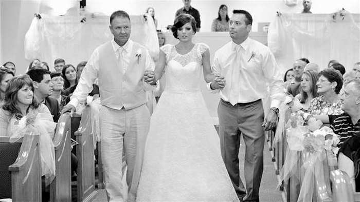 Katie walking down the aisle with two guys