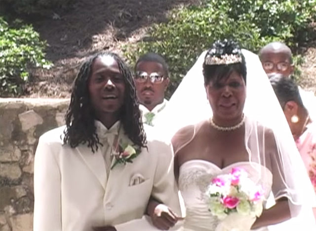 Son Sings While Walking With Mother At Her Wedding