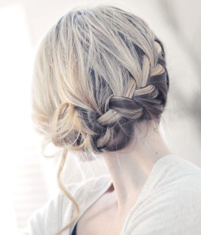 A low french braid gives intrigue and beauty all at once.