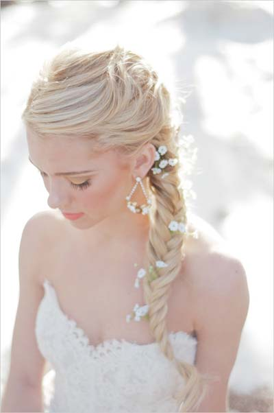 The only day it's really acceptable to have so many flowers in your hair is your wedding, and this look is a fabulous option.