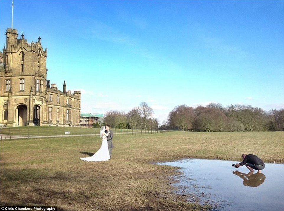 Chris Chambers Deep In The Puddle Taking Wedding Photo