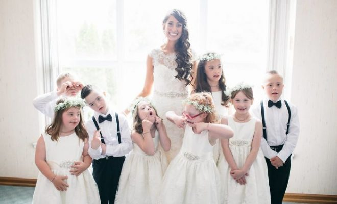 Kinsey French, a special education teacher at Christian Academy's Rock Creek campus in Louisville, Kentucky with her students at her wedding