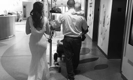 Celia and Jeff Kinzel carry their son Logan back to his hospital room after their wedding