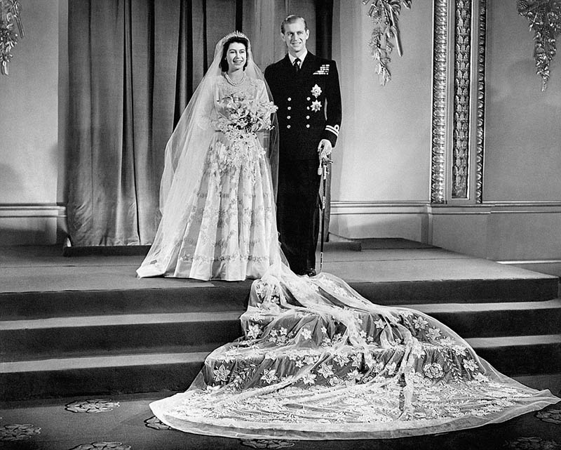 1947: The big day: Princess Elizabeth and Lt Philip Mountbatten photographed at Buckingham Palace after their wedding ceremony, held at Westminster Abbey on 20 November.  Elizabeth's dress was the work of Norman Hartnell, Court Designer since 1938.  The lavish gown boasted a 13ft long train that was said to have been inspired by a Boticelli painting.