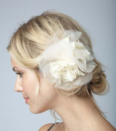A flower applique is a great alternative to a veil on the big day.