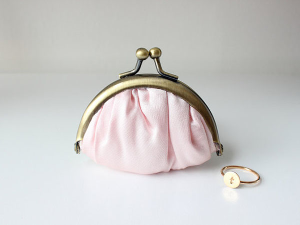 A tiny kiss-lock purse for a ring bearer