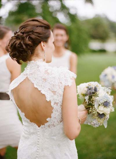 This classic twisted bun leaves guests breathless at your wedding.