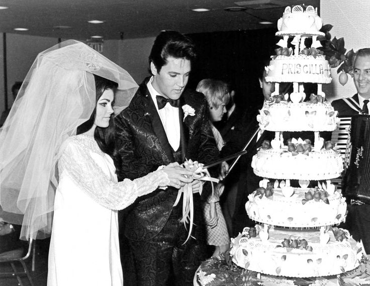 Elvis and Priscilla Presley cut their wedding cake