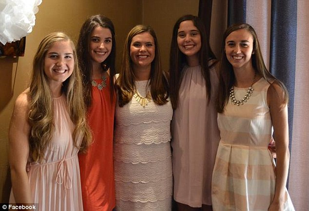 Quinn Duane (pictured center) with her bridal party
